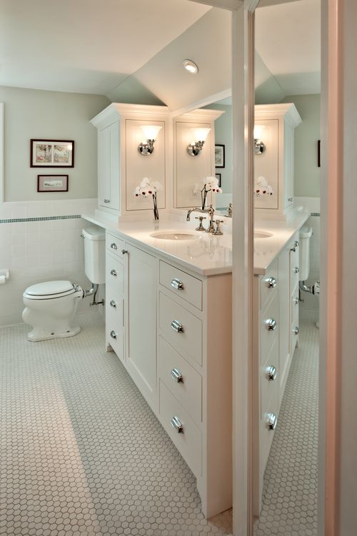 Great We replaced the wall mounted sink with a built in vanity and added a linen cabinet over the toilet for extra storage The vanity cabinet was pushed back