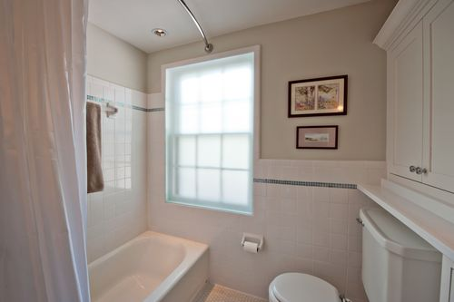Fancy  the room by installing an opaque glass panel in the window eliminating the need for window treatments We also replaced the drop down shower curtain rod